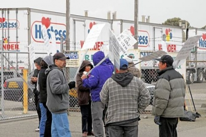 Striking workers picket outside the Hostess bakery in Oakland, Calif. in November.