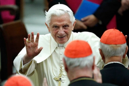 Pope Benedict XVI waving as he leaves Paul VI hall after attending a concert in November, 2011.