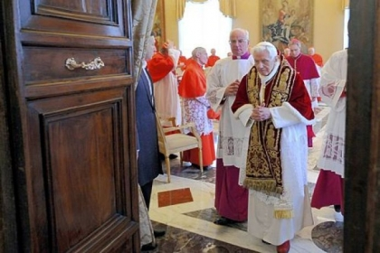 Pope Benedict XVI leaves an ordinary consistorio at the Vatican on Monday after announcing he will resign Feb. 28.