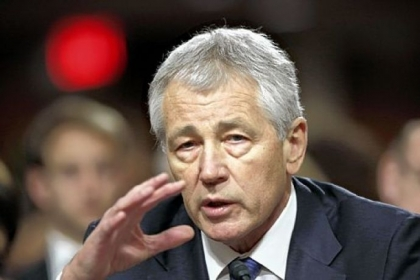 Senate Armed Services Committee votes 14-11 in favor of Chuck Hagel to be defense secretary.