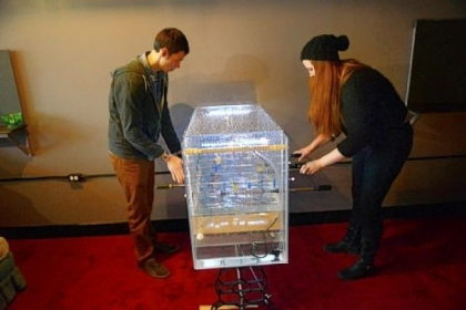 Nick Barletta and Corinne Hogge work a foosball machine at PLAY Parlour in Lawrenceville.