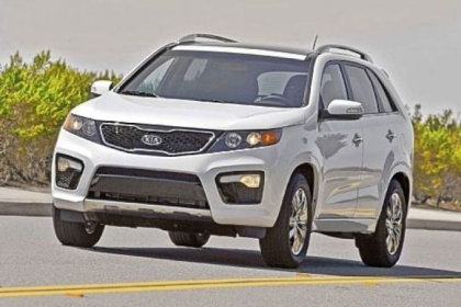 The 2013 Kia Sorento offers families seven SUV seats on a budget.