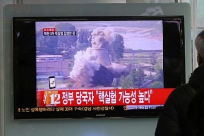 A South Korean man watches TV news showing file footage of the demolition of the cooling tower of the Yongbyon nuclear complex, following a report of a possible nuclear test conducted by North Korea, Tuesday at the Seoul train station in Seoul, South Korea.