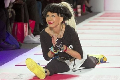 Designer Betsey Johnson greets the audience with her trademark cartwheel and split following a showing of her fall 2013 collection Monday.