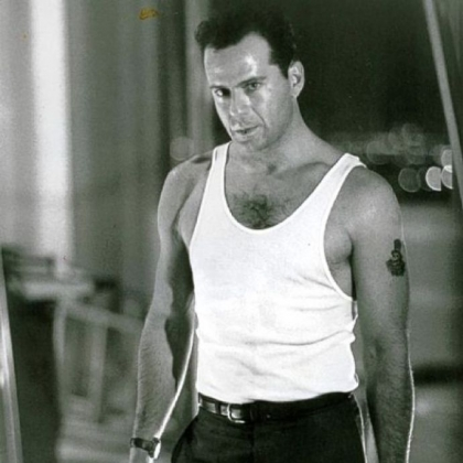 "Bruce Willis in the original ""Die Hard"" film, released in 1988 by Twentieth Century Fox."