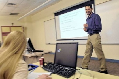 Carlow associate professor Cory Maloney, teaching about open source computer programming, uses a lower-cost, customized e-textbook for his students.