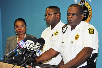 Commander Eric Holmes, left, and Chief Nate Harper at a news conference in September.