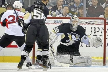 Marc-Andre Fleury makes one of his 27 saves in winning for the sixth time this season.
