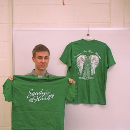 Sales of Noah Sims' T-shirts will benefit Sandy Hook Elementary School in Connecticut.