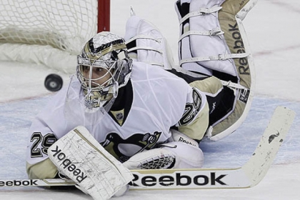 Penguins goaltender Marc-Andre Fleury hits the ice after making a save against the Jets during the first period.