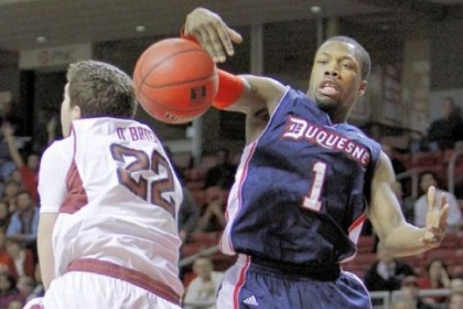 Duquesne's Derrick Colter knocks a rebound away from Temple's Jake O'Brien in the second half Thursday in Philadelphia. Duquesne earned its first Atlantic 10 win of the year, 84-83.