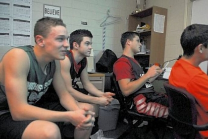 Members of the Fox Chapel High School boys basketball team Greg Fiorillo, Josh Dunlap, David Brown and Roy Smith review film before practice Tuesday.