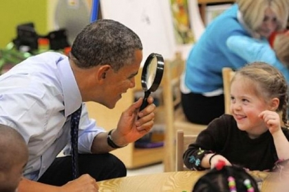 President Barack Obama uses a magnifying glass to play with a young girl Thursday during a visit to College Heights Early Childhood Learning Center in Decatur, Ga. The president is proposing a nationwide initiative for children in pre-kindergarten.
