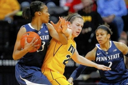 Iowa guard Samantha Logic, center, puts pressure on Penn State forward Ariel Edwards Thursday at Carver-Hawkeye Arena in Iowa City, Iowa.