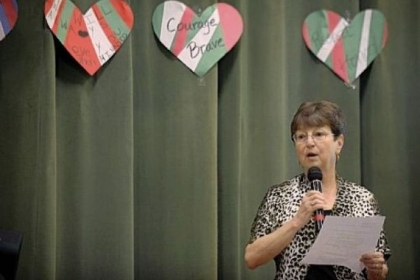 Susanne Pearson Evans speaks Thursday to students at Minadeo School in Squirrel Hill and via Skype to students at Minadeo School in Montagano, Italy. Mrs. Evans was injured in a traffic accident in 1954 in which 15-year-old John Minadeo was killed while saving several students. The schools in Pittsburgh and Italy are named after the young hero.
