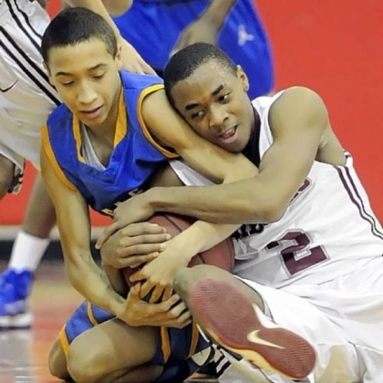 East Allegheny's Jordan Williams fights for a loose ball against Ambridge's Stephon McGinnis Friday.