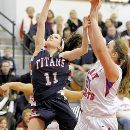 Shaler sophomore Lizzie Kline reaches for a rebound against Chartiers Valley's Kristin McGeough.