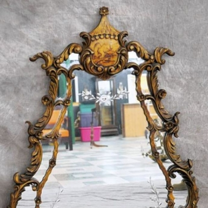 A Chippendale style chinoiserie gesso mirror with cut glass.