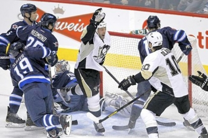 Craig Adams celebrates his goal with Tanner Glass (10) against Jets goaltender Ondrej Pavelec in the first period Friday in Winnipeg, Manitoba.