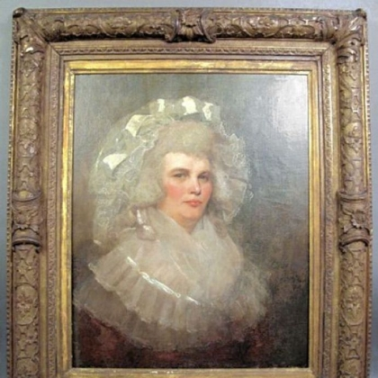 Portrait of a lady with lace hat.