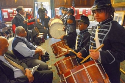 Marshall Anderson, 13, right, and other members of Soldiers & Sailors 6th Regiment USCT Drum Corps, perform during the third annual African American Heritage Celebration at Soldiers & Sailors Memorial Hall & Museum in Oakland on Saturday.