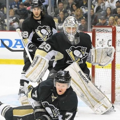 Penguins defenseman Paul Martin makes a save in front of goalie Marc-Andre Fleury.