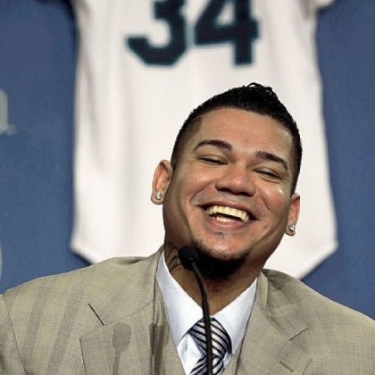 Why is this man smiling? Well, Felix Hernandez has 175 million reasons after signing a new contract with the Mariners.