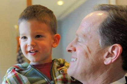 Sen. Pat Toomey stops in his office between meetings Tuesday to greet his son Duncan, 2.