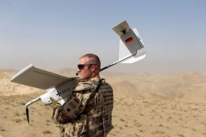 A German Bundeswehr holds an EMT Aladin airborne reconnaissance drone for close area imaging during a regular patrol near Mazar-e-Sharif, Afghanistan.
