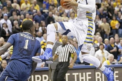 Marquette's Vander Blue scored 19 points -- 14 in the first half -- in a win against Pitt Saturday.