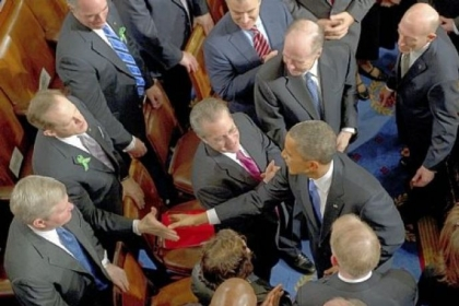 Sen. Toomey, left, shakes hands with President Barack Obama after Mr. Obama delivered the State of the Union address Tuesday in the House of Representatives.