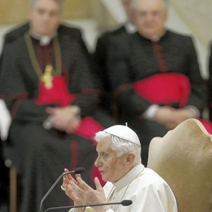 Pope Benedict XVI talks during an audience the with Roman clergy, in the Paul VI Hall at the Vatican, Thursday, Feb. 14, 2013.
