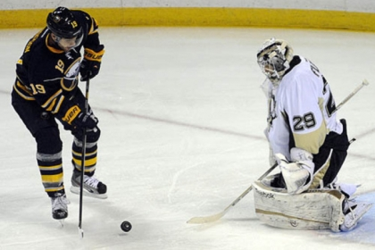 Buffalo Sabres center Cody Hodgson shoots the puck against Penguins goaltender Marc-Andre Fleury during the first period of an NHL hockey game in Buffalo, N.Y.