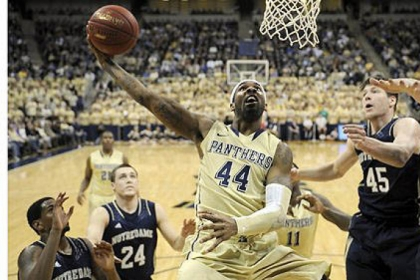 Pitt forward J.J. Moore drives to the net against Notre Dame in the first half at the Petersen Events Center Monday.