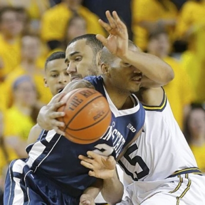 Penn State guard D.J. Newbill (2) is defended by Michigan forward Jon Horford (15) in the second half Sunday at Crisler Center in Ann Arbor, Mich.