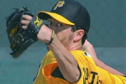 Pirates right-hander Jeff Karstens throws Sunday in Bradenton, Fla.