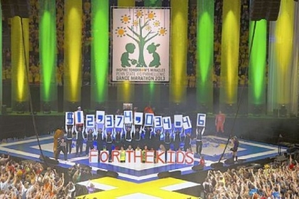 THON 2013 volunteers display the total of more than $12.4 million  raised for the Four Diamonds Fund at Sunday's end of the 46-hour event