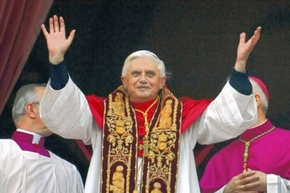 Pope Benedict XVI greets the crowd from the central balcony of St. Peter's Basilica moments after being elected on April 19, 2005, at the Vatican.