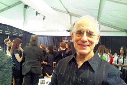 Philip Pelusi backstage at Mercedes-Benz Fashion Week Feb. 9 at Lincoln Center on Manhattan's Upper West Side. He and a team of stylists designed a Parisian-inspired hairstyle for models in the Venexiana runway show.