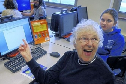 Laryn Finder of Upper St. Clair is happy with her computer help in a class, Computer 101, where seniors learn from Mellon Middle School students of the Mt. Lebanon School District, including Mia Agostinelli, 12, right, a sixth-grader.