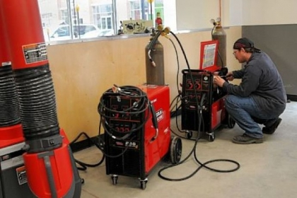 An employee of TechShop sets up mig welders Friday in preparation for the opening of the DIY workshop and fabrication studio for artists, machinists, inventors or dabblers in Bakery Square.