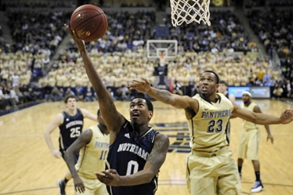 Notre Dame&#039;s Eric Atkins drives to the net against Pitt&#039;s Trey Zeigler.