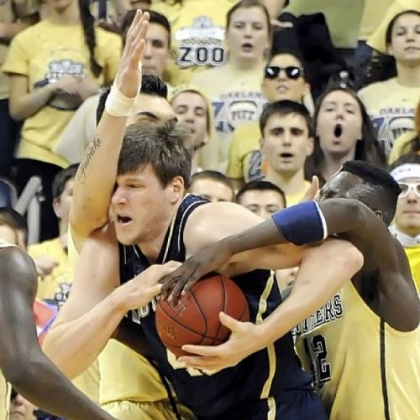 Pitt's Steven Adams and Talib Zanna fight for the ball against Notre Dame's Jack Cooley in the first half Monday at Petersen Events Center.