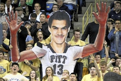 Pitt students hold up a giant cutout of freshman center Steven Adams as their team takes on Notre Dame in the second half Monday at Petersen Events Center.