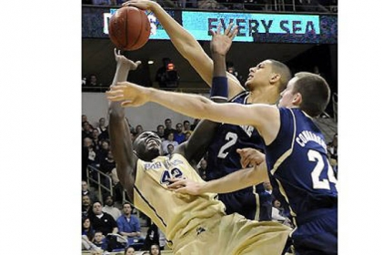 Notre Dame's Zach Auguste blocks a shot by Pitt's Talib Zanna in the first half.