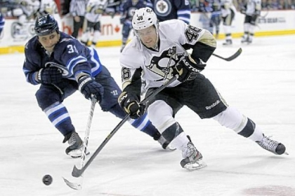 Joe Vitale drives for the net against the Jets&#039; Dustin Byfuglien in the second period Friday in Winnipeg, Manitoba.