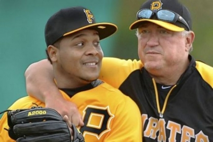 Pirates manager Clint Hurdle sneaks up on infielder Anderson Hernandez at drills Feb. 14 at Pirate City, in Bradenton, Fla. Hurdle, entering the final year of his contract, is expected to receive an extension through 2014 with a club option for 2015.