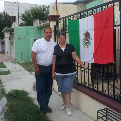 Jose Pedro Verde-Rodriguez and Andria Verde stand near their home in Matamoros, Mexico, in September.