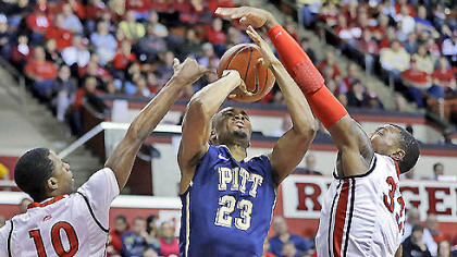 Trey Zeigler has his shot blocked by Rutgers defender Wally Judge (33) as Rutgers' Mike Poole (10) helps out.