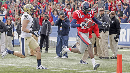 Mississippi wide receiver Vince Sanders scores a touchdown as Pitt defensive back Anthony Gonzalez pursues in the first half of 